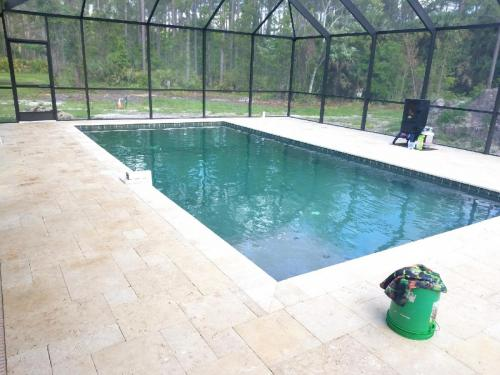 Bunnell-pool-construction-travertine-deck-1