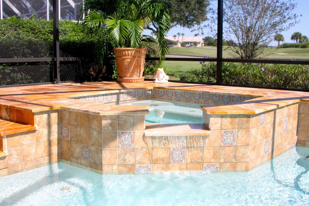 Custom pool and spa combo with travertine decking