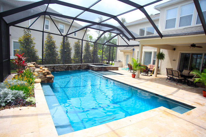 Custom residential pool and spa combo with waterfall features