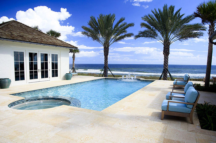 Custom pool and spa combo with travertine deck