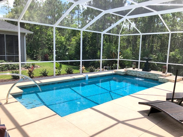 Custom pool with raised waterfall features in Ormond Beach