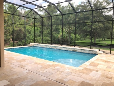 Custom pool with raised waterfall features in Port Orange