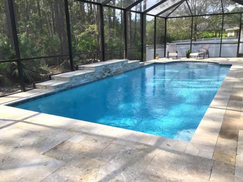 Custom pool with raised wall water feature