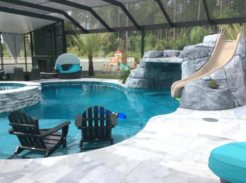 Custom pool with grotto and slide