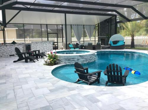 Custom pool with spa, grotto, summer kitchen