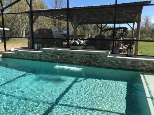 Bunnell-pool-construction-with-raised-ledger-stone-backwall-and-sheer-descent-waterfall-1