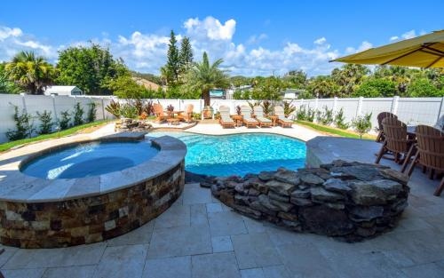 Custom-raised-spa-and-waterfall-in-flagler-beach