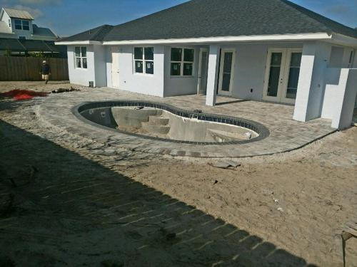 Ormond-Beach-pool-construction-with-paver-deck-2