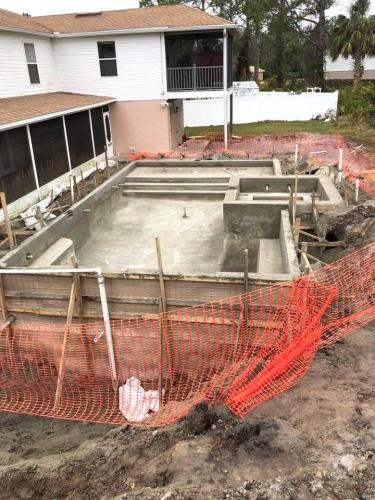 Palm-Coast-Pool-construction-with-rasied-spa-20x40-shell-complete