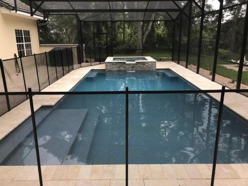Palm-Coast-pool-spa-construction-travertine-deck-waterfall-feature