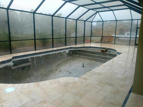 St-Johns-pool-construction-tarvertine-deck-completed