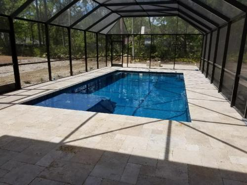 St-Johns-pool-construction-with-travertine-deck-2