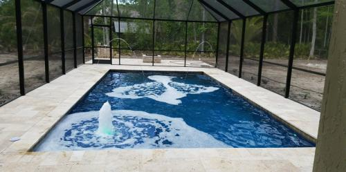 St-Johns-pool-construction-with-travertine-deck-3