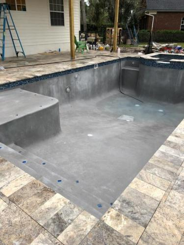 custom-pool-with-raised-spa-travertine-deck-and-coping-1