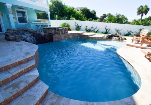 custom-pool-with-rock-waterfall-and-raised-spa-3