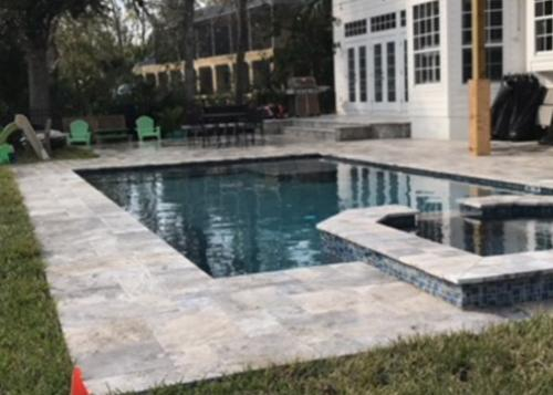 flagler-beach-custom-pool-with-raised-spa-travertine-deck-6